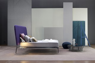 a lightweight metal structure contrasting with a large over-sized head board.