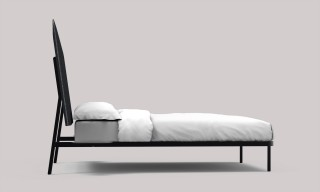 a head board with an angled position provides extra comfort when reading or working in the bed.