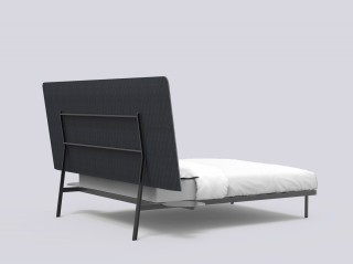 a bed that has been designed to look good from the back too so it could be placed in the middle of a room.