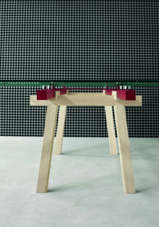 as if the table was just a layering of different and separate elements in different materials.