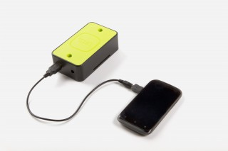 "the ""Turtle"" add-on charging a phone."