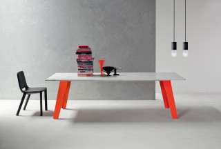 welded table with flashy orange legs and white carrara marble.