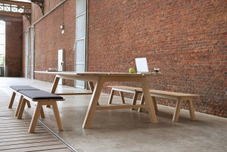 a versatile table that can either serve as a common eating table, a gathering point for group interactions, a temporary working space, or just as a workbench.